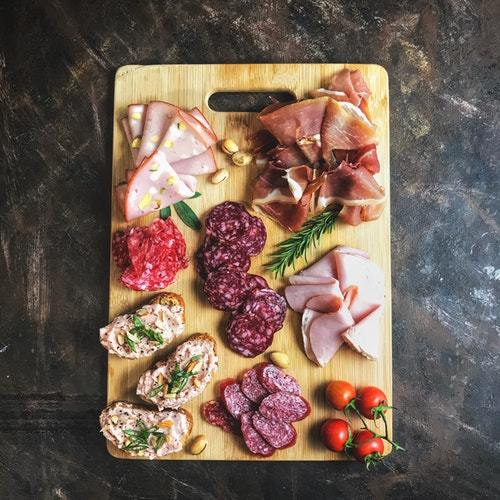 sliced-meats-on-wooden-chopping-board-1927383.jpg